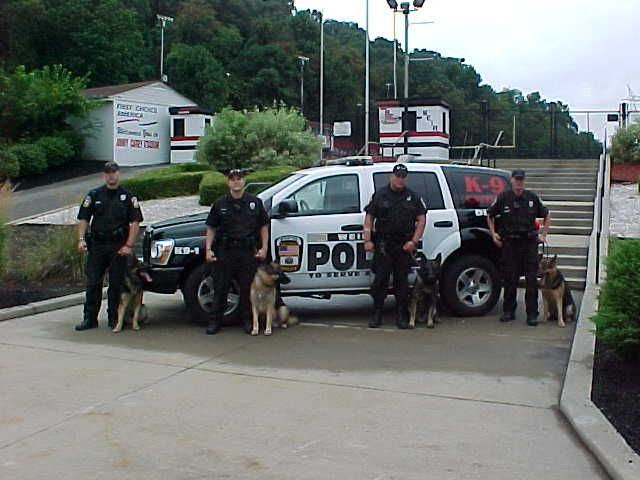 The Weirton K9 Unit in front of a patrol SUV.